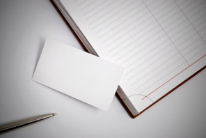 Empty business card with diary and pen