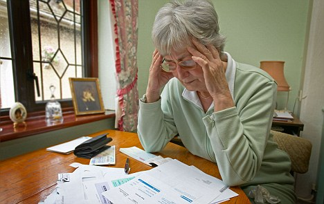 AP20C7 old age pensioner worrying about bills