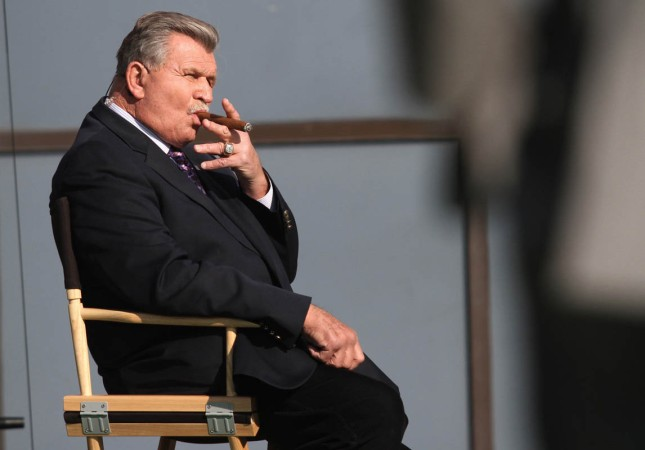 Mike Ditka smokes a cigar on the set of Sunday NFL Countdown in Indianapolis, Ind. .Photo by Chris Bergin