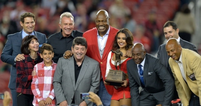 Sep 14, 2015; Santa Clara, CA, USA; San Francisco 49ers former defensive end Charles Haley (center) poses with Steve Young, Denise DeBartolo York, Eddie DeBartolo Jr., Joe Montana, Jerry Rice, Jed York and Ronnie Lott during halftime ceremony at Levi's Stadium. Mandatory Credit: Kirby Lee-USA TODAY Sports