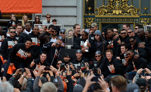 SAN FRANCISCO, CA - OCTOBER 31: The San Francisco Giants poses pictures with the 2012 World Series Trophy during the Giants' victory parade and celebration on October 31, 2012 in San Francisco, California. The Giants celebrated their 2012 World Series victory over the Detroit Tigers. (Photo by Thearon W. Henderson/Getty Images)