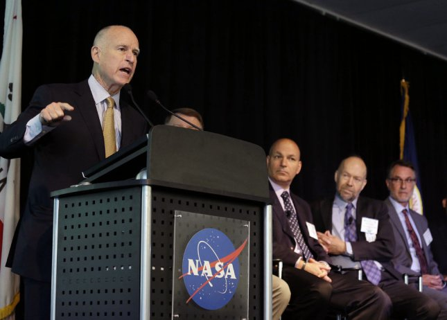 California Gov. Jerry Brown speaks to researchers and scientists during a call to action on climate change at the Water, Energy and Smart Technology Summit and Showcase at NASA Ames Research Center Thursday, May 23, 2013 in Mountain View, Calif. Listening from left, are panelists Waleed Abdalati, James E. Hansen, Dr. Anthony D. Barnosky, and Banny Banerjee. Brown warned scientists and policymakers Thursday that they are losing the war on climate change and urged them to become advocates for the planet.  (AP Photo/Eric Risberg)